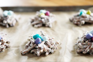 coat pretzels in melted white chocolate and top with a few colorful candies