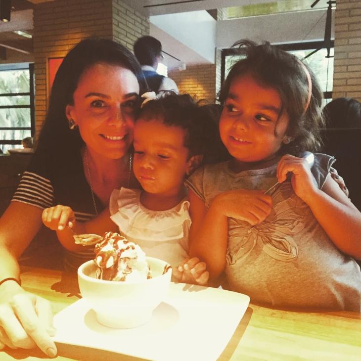 Enjoying an ice cream sundae together! How sweet it is!