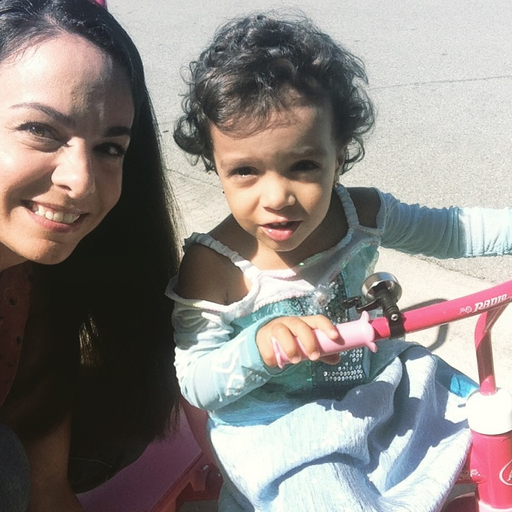 My little princess going out for a ride on her tricycle!